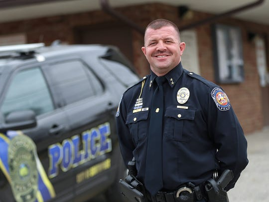 Southport police chief Tom Vaughn poses outside the