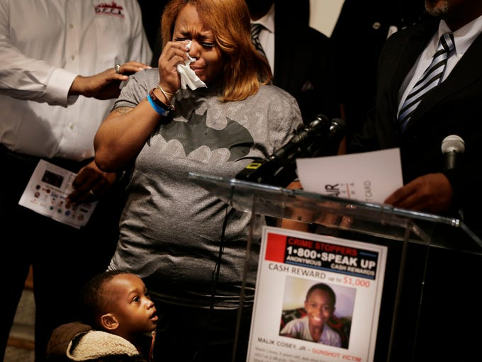 Antonio Hobson, 2 stands by his aunt Ciera Milo, the