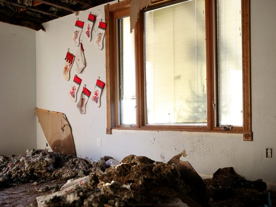 Christmas stockings hang on the wall of a Keizer home