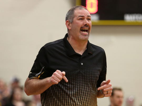 Cascade head coach Steve Ball calls out to his team