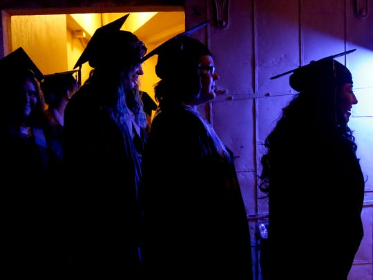 Graduates lineup backstage during the Roberts High