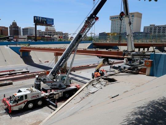 Crews work July 20, 2018, to repair a Downtown overpass that was damaged July 19, 2018, in a fiery semitrailer crash that forced the closure of Interstate 10 in Downtown El Paso.