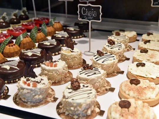 Rows of pastries fill a case at La Brioche Patisserie in Fondren.