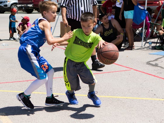 Gabriel Herrera of the Rockstars2 team dribbles to the basket in the Gus Macker 3 on 3 basketball tournament junior division.