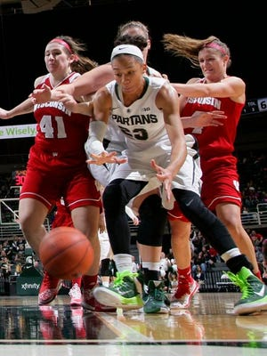 Michigan State's Aerial Powers, center, chases the ball against Wisconsin's Rosanna Gambino (41) and Nicole Bauman Sunday in East Lansing. Michigan State won 77-67.