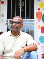 Tyree Guyton poses in front of the Dotty house at the