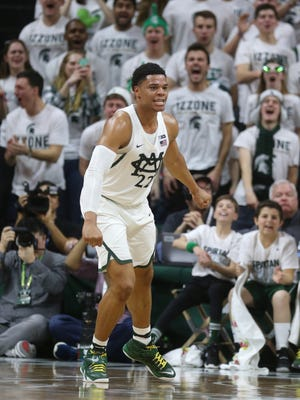 Michigan State forward Miles Bridges reacts after scoring against Michigan in the first half Sunday, Jan. 29, 2017 at the Breslin Center in East Lansing.