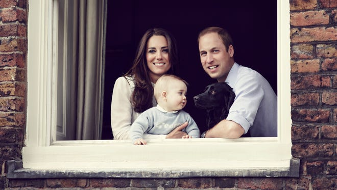 Prince William, Duke of Cambridge, Catherine, Duchess of Cambridge and Prince George of Cambridge pose for an official family portrait at Kensington Palace, ahead of their tour to Australia and New Zealand, with their pet dog Lupo on March 18, 2014 in London, England.