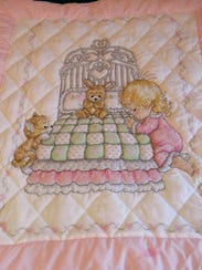 A baby quilt Darlene Ostendorf embroidered and donated