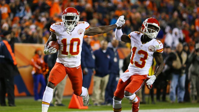 Wide receiver Tyreek Hill #10 of the Kansas City Chiefs celebrates with De'Anthony Thomas #13 after returning a kickoff for a touchdown in the second quarter of the game against the Denver Broncos at Sports Authority Field at Mile High on November 27, 2016 in Denver, Colorado.