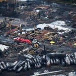 Workers comb through debris July 9, 2013, after an oil train derailed and exploded in the town of Lac-Megantic, Quebec .   In January, the National Transportation Safety Board and Transportation Safety Board of Canada called on regulators to require railroads to take stock of   risks along certain   routes and change them if needed.