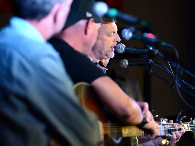 Country music star and songwriter Darryl Worley sings during the Darryl Worley and Friends Songwriters' benefit concert, Tuesday, July 22, 2014 at Bumpus Harley-Davidson of Jackson. Songwriters included Walt Aldridge, Keith Anderson and Kendell Marvel.