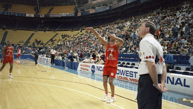 Louisville coach Denny Crum watches Clifford Rozier put up a basket during practice, Wednesday, March 25, 1993, St. Louis, Mo. Crums Cardinals face Indiana Thursday in the first round of the NCAA Midwest Regionals.
