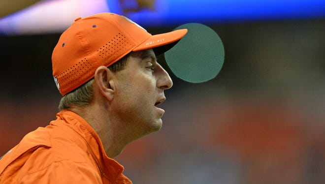 Clemson head coach Dabo Swinney coaches against Syracuse during the 4th quarter at the Carrier Dome in Syracuse, N.Y., Saturday, Nov. 14, 2015.