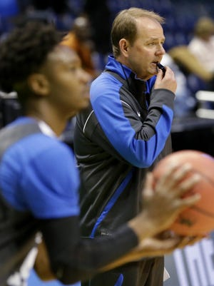 MTSU coach Kermit Davis (right) directs his team during practice for the first round of the NCAA Division I Men's Basketball Championship at the BMO Harris Bradley Center.