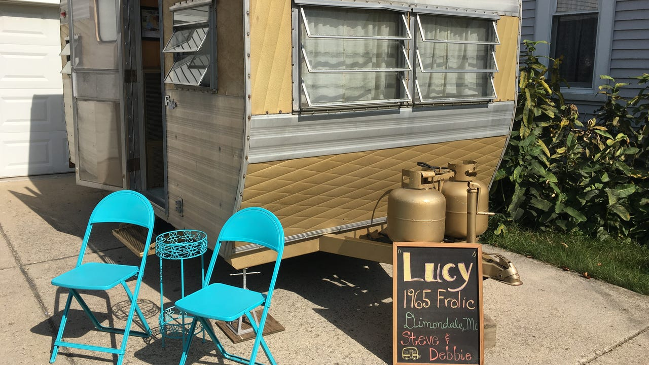 "Stevie and Debbie Viele purchased a 13-foot-long vintage camper in St. Johns two years ago. It's still the original color. It still has the original appliances. And it's been decorated to give it that ""homey"" feel."