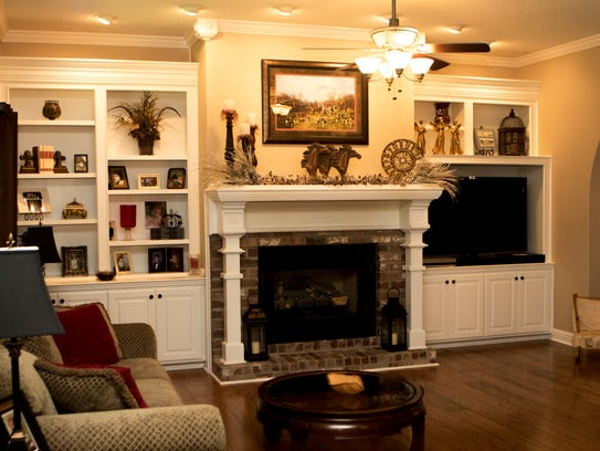 The fireplace is the centerpiece of the living room
