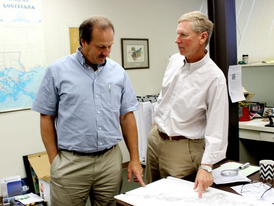 Bossier's Director of Public Works Gary Neathery, left,