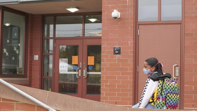 Pell Elementary School fourth-grade student Amina Rose, 9, waits for the school day to begin in September.