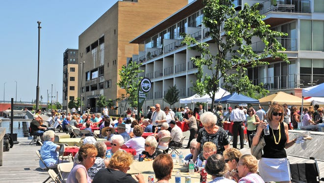 Dine on the Deck is a popular weekly summertime lunch concert at CityDeck in downtown Green Bay.