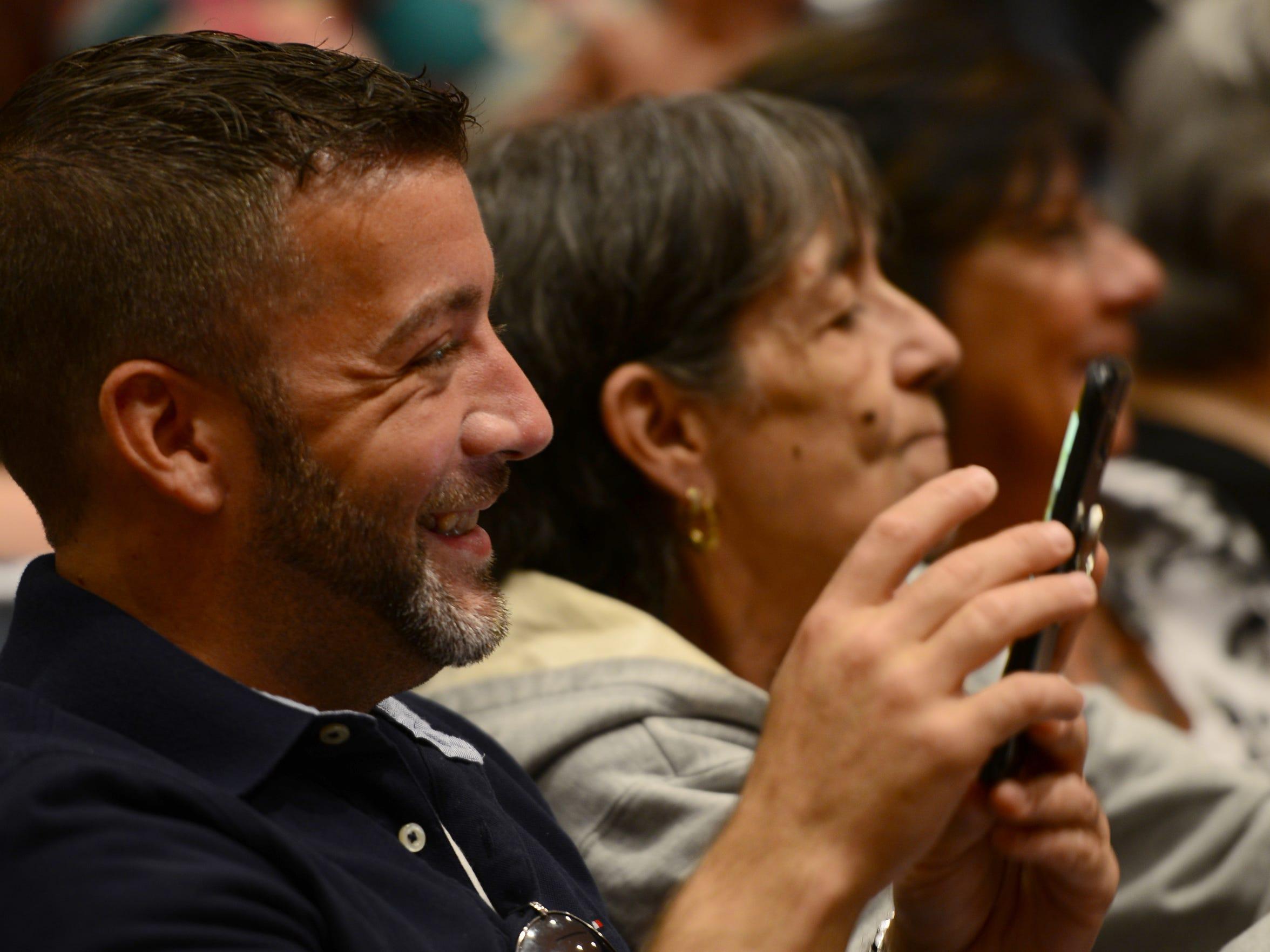 Kevin Garrett takes a photo of his fiancée, Amanda