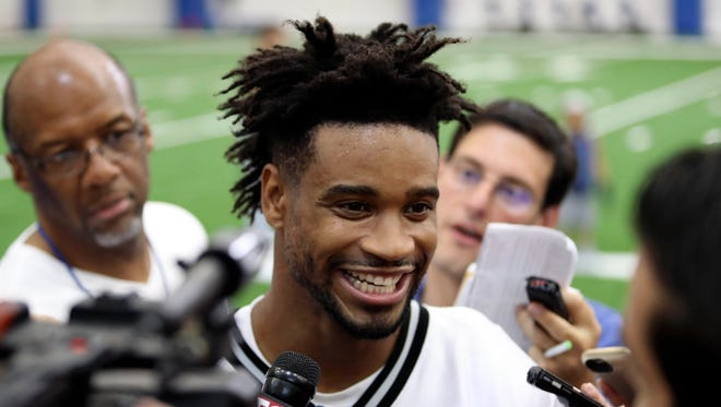 Jul 29, 2016; Allen Park, MI, USA; Detroit Lions cornerback Darius Slay (23) talks to the press and smiles after practice at the Detroit Lions Training Facility.