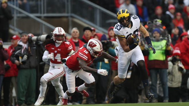 Michigan's Zach Gentry makes a catch against Wisconsin's Natrell Jamerson in the second quarter Saturday, Nov. 18, 2017 at Camp Randall Stadium in Madison, Wis.