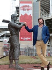 Reds chief operating officer Phil Castellini stands outside Great American Ball Park with a statue of former Reds great Ted Kluszewski.