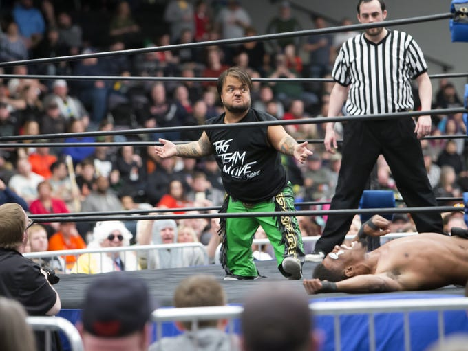 Swoggle reacts after taking the opponent down during
