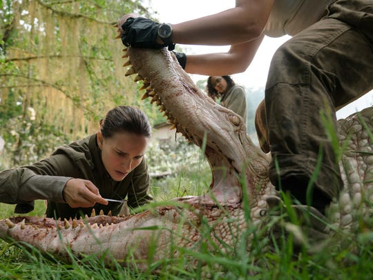 "Natalie Portman, left, in a scene from ""Annihilation."""