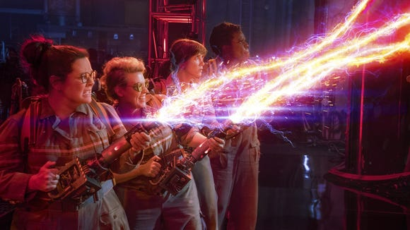 "Melissa McCarthy, from left, Kate McKinnon, Kristen Wiig and Leslie Jones appear in a scene from ""Ghostbusters."""