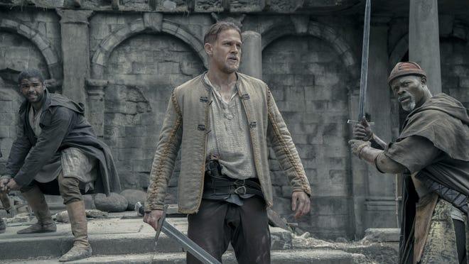 "Kingsley Ben-Adir, Charlie Hunnam and Djimon Hounsou in ""King Arthur: Legend of the Sword."""