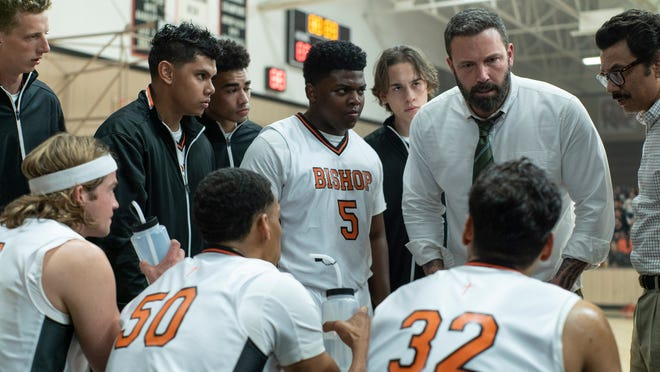 Jack Cunningham (Ben Affleck) has an intense discussion with his players.
