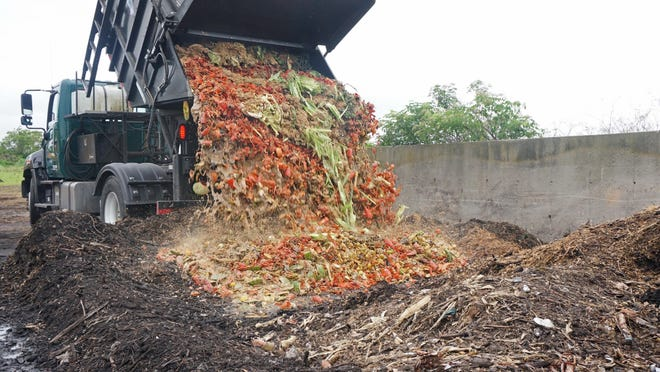 Food scraps are dumped at a Middletown site where they will be turned into nutrient-rich compost by Clean Ocean Access, an environmental group that has also led the drive to ban single-use plastic bags in R.I.