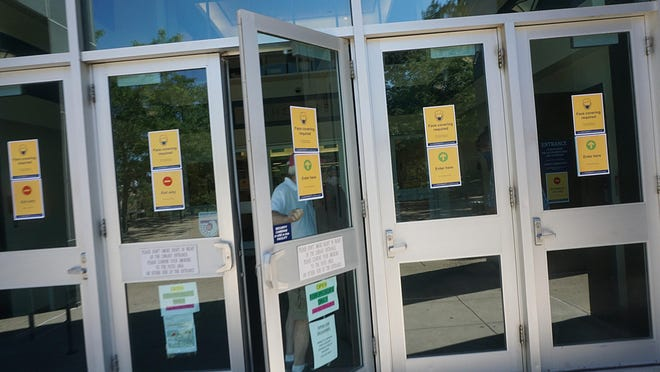 Signage with safety instructions starts at the doors of Robert L. Carothers Library and Learning Commons at URI.  URI has been preparing for reopening the school safely for students.