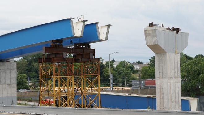 In continuing work on the Route 6/10 exchange, a giant tub girder, lower center, sits on a flatbed tractor-trailer on Wednesday, awaiting installation above.