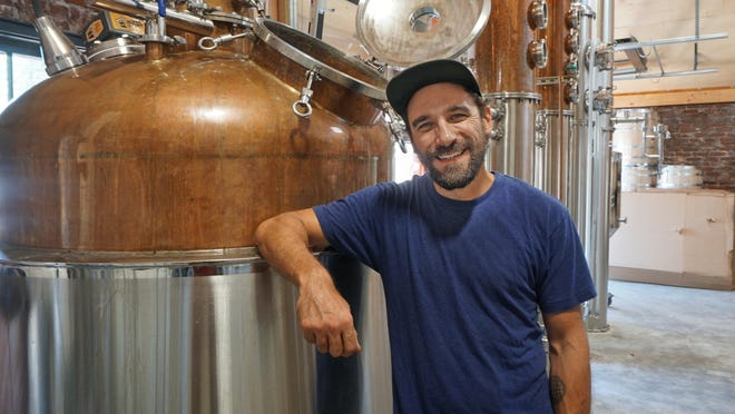 South County Distilling co-owner and distiller Ryan Gwozdz next to a still at the Westerly campus that also includes Grey Sail Brewing.