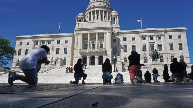 Participants at Saturday's student protest in support of Black Lives Matter remember George Floyd with 8 minutes and 46 seconds of silence while kneeling in front of the State House.