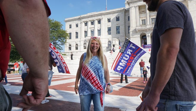 Doreen Costa, the Republican Senate candidate for District 36, works the crowd at a Donald Trump rally at the State House on Saturday.