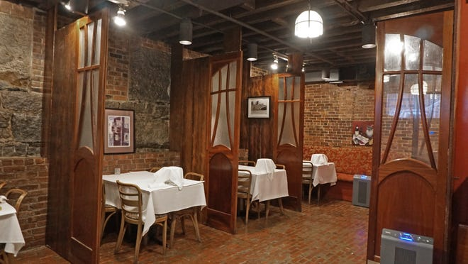 Pot au Feu just reopened for inside dining with 10 tables, elegant separations for tables and layers of COVID protection.