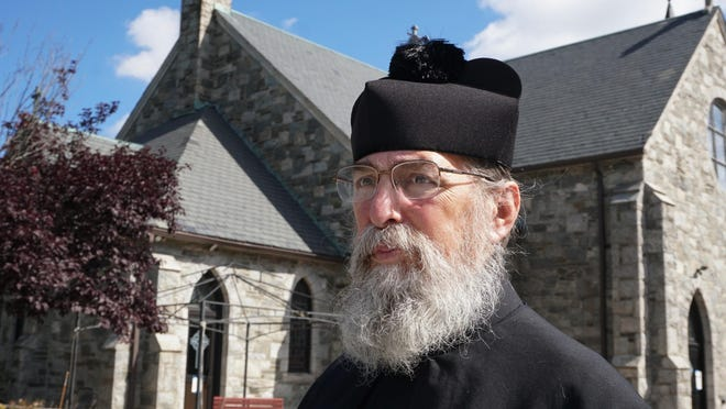 """Father D. Timothy O'Mara presides over a church that's in both North Smithfield, Rhode Island, and Blackstone, Massachusetts. Because Massachusetts considers attending religious services a """"critical life activity,"""" it is not affected by the state's travel restrictions."""