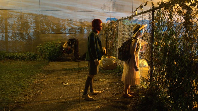 Paul (Jaeden Martell) and Aristiana (Sophie Giannamore) wonder what's beyond the fence.
