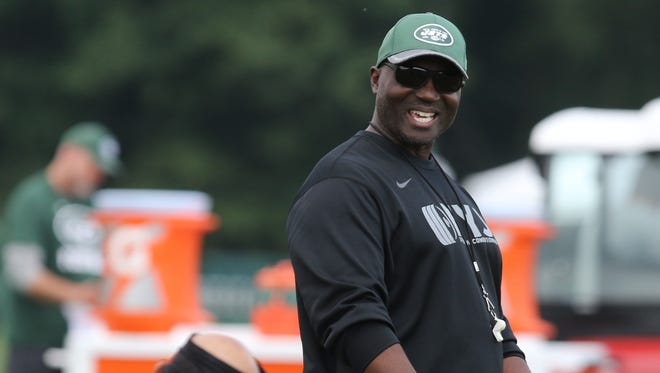 Jets coach Todd Bowles communicating with safety Rontez Miles during practice.