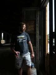 Craig Wensell walks through the future site of Wilmington Brew Works last month.