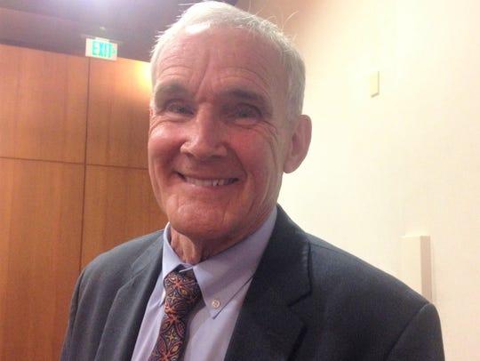 County Supervisor Steve Bennett smiles after the vote