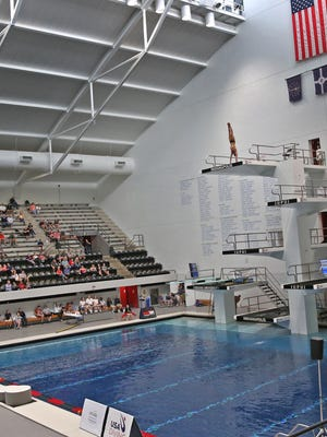 Divers are dwarfed in the arena as they dive from the top platform during the 2017 USA Diving FINA World Championships Senior Men Platform Final at the IUPUI Natatorium, Sunday, May 21, 2017.