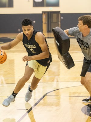 Matthew Moyer, a Syracuse transfer, works through a drill with Vanderbilt assistant coach Casey Shaw during summer practice.