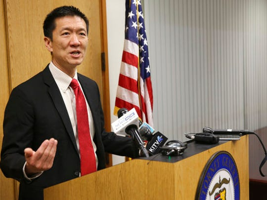 FILE - In this March 9, 2017, file photo, Hawaii Attorney General Douglas Chin speaks at a news conference in Honolulu. The day before it is supposed to go into effect President Donald Trump's revised travel ban will be scrutinized in federal courtrooms across the country on Wednesday, March 15. Hawaii will argue that the new order will harm its Muslim population, tourism and foreign students.