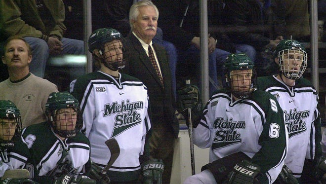 MSU head hockey coach Ron Mason, center, watches with his team in 2002, his final year at the helm.