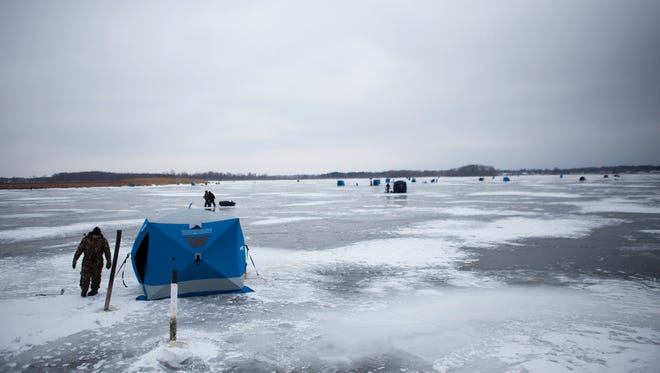 Ice fishermen and their shanties dot the landscape on Braddock Bay in Greece.